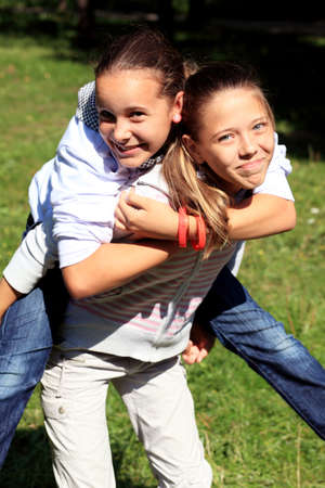 best friends: Happy children are having fun outdoors.