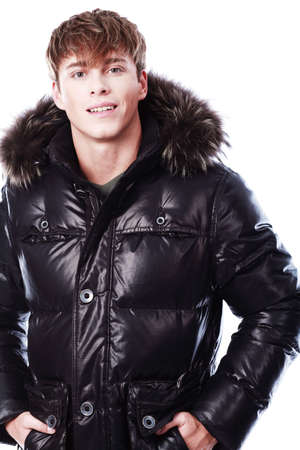 Portrait of a professional male model in winter clothes. photo
