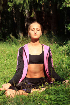 Young woman meditating outdoor, calmness. Stock Photo - 5716423