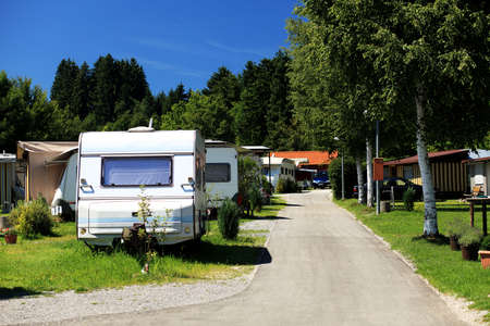 camper trailer: Camping car based at a camping area. Stock Photo