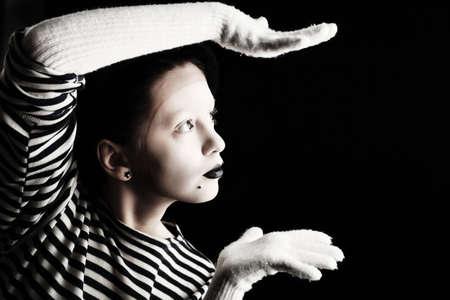 striped vest: Portrait of a female mime in sailors striped vest.