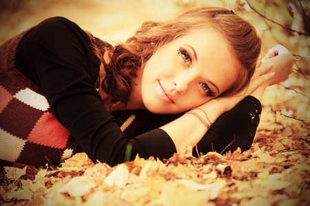 Young pretty woman at the autumn park. Stock Photo - 5736297