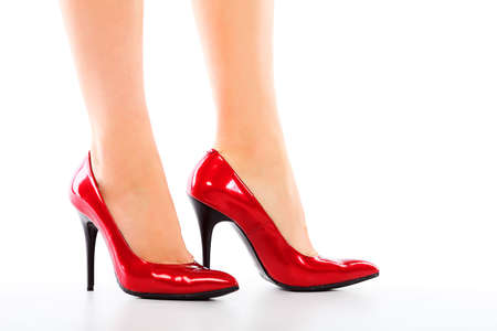 woman legs and red shoes on white background Stock Photo - 5762937