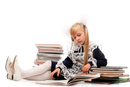 school form: Portrait of a schoolgirl on a stack of books.