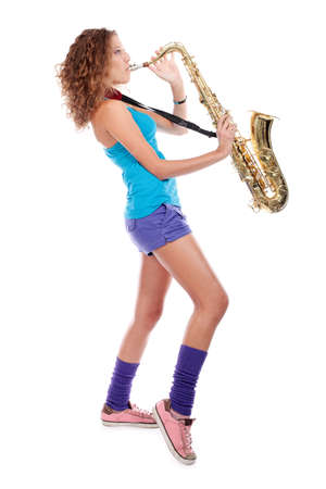 Portrait of a woman playing the saxophone. photo
