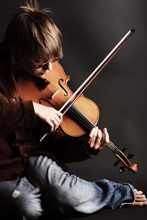 rosin: A young woman playing her violin with expression.