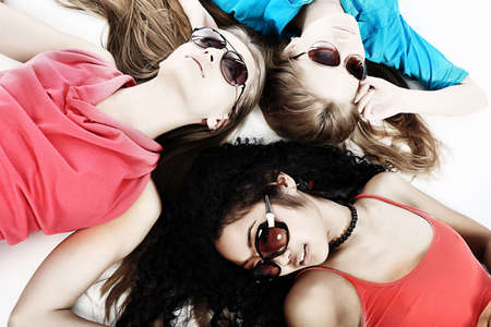 Group of a cheerful young women. Beauty education, holidays. photo