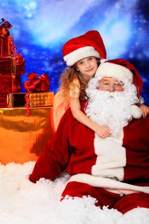 st claus: Christmas theme: Santa, gifts, snowy design, child. Stock Photo
