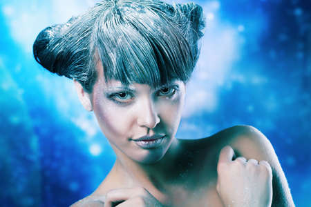 sexy women naked: Portrait of a snow female model over sky of stars and snow. Fashion, beauty. Stock Photo