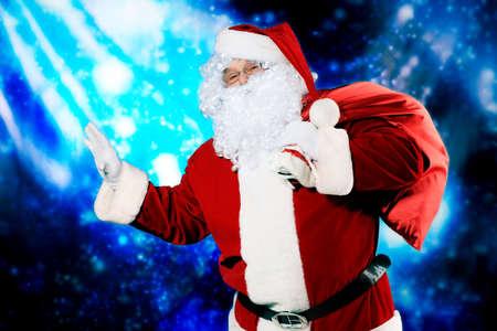 Christmas theme: Santa, gifts, snowy design. photo