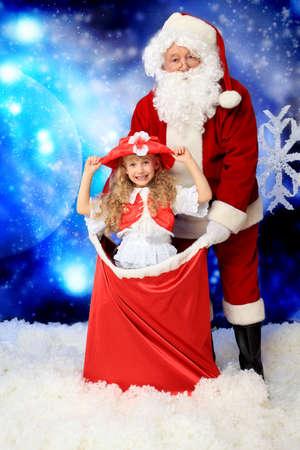 st  nick: Christmas theme: Santa, gifts, snowy design, child. Stock Photo