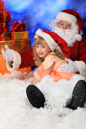 Christmas theme: Santa  gifts, snowy design, child. photo
