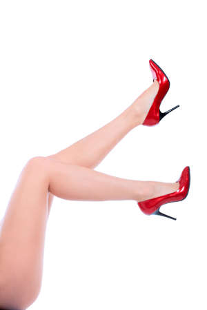 Female legs in elegant red shoes on white background Stock Photo - 5858321