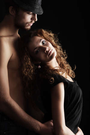 Portrait of a sexual couple. Shot in a studio. Stock Photo - 5877126