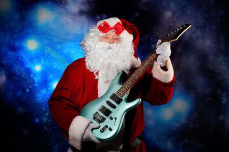 snow man party: Christmas theme: Santa claus playing a guitar, snowy design.