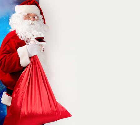 Christmas theme: Santa  gifts, snowy design. photo
