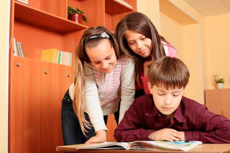 Educational theme: schoolchildren in a classroom. Stock Photo - 5898853