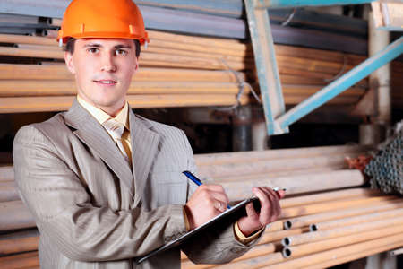 Industrial theme: a blue collar working at a manufacturing area.   Stock Photo - 5898827