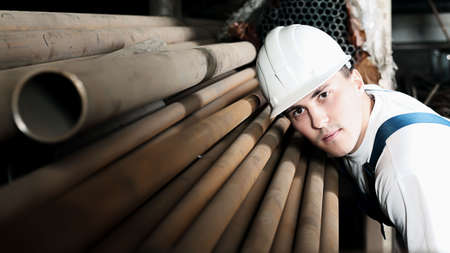 Industrial theme: a worker at a manufacturing area. photo