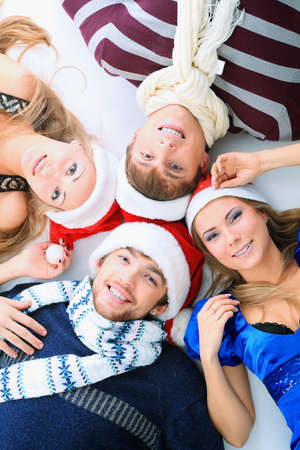people celebrating: Group of young people celebrating christmas.