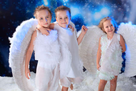 Beautiful little angels at a snowy background. Stock Photo - 5941842