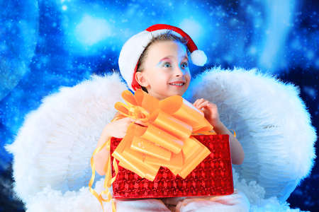 Beautiful little angelic child  with a present at a stellar sky. Stock Photo - 5941844
