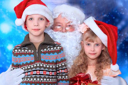 Christmas theme: Santa  gifts, snowy design, children. photo