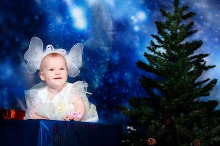 Christmas child sitting on a big present against night stellar sky. Stock Photo - 5938097