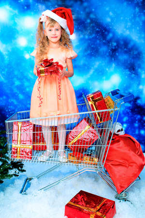 Christmas theme: cute girl with her gifts, seasonal sale.  photo