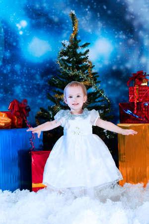 Christmas child standing in snowdrift against night stellar sky. Stock Photo - 5938081