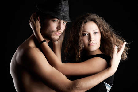 Portrait of a sexual couple. Shot in a studio. photo