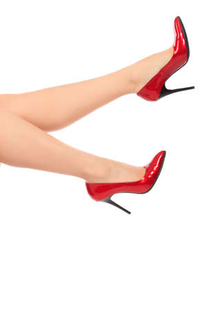 Female legs in elegant red shoes on white background Stock Photo - 6027651