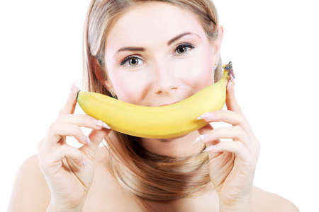 Portrait of a beautiful young woman holding banana. Stock Photo - 6078512