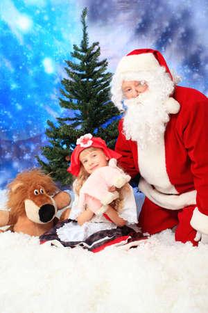 nick: Christmas theme: Santa  gifts, snowy design, child. Stock Photo