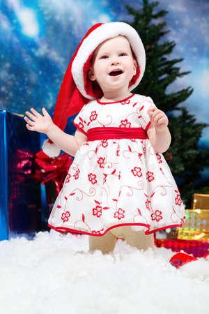 snowdrift: Christmas child standing in snowdrift against night stellar sky.