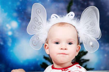 Christmas child against night stellar sky. Stock Photo - 6140814