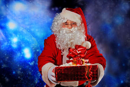 Christmas theme: Santa  gifts, snowy design. Stock Photo - 6098331