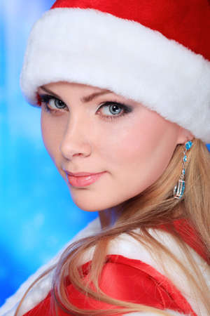 Portrait of a beautiful young woman wearing christmas clothes over sky of stars and snow. Stock Photo - 6098361