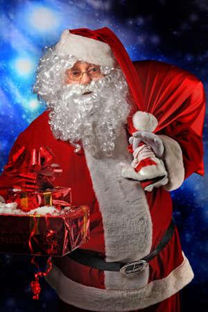 Christmas theme: Santa  gifts, snowy design. Stock Photo - 6098329