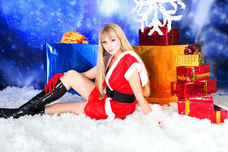 Portrait of a sexy young woman wearing christmas clothes over sky of stars and snow. Stock Photo - 6098553