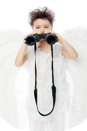 Beautiful little angel looking through a binocular. Isolated over white background. Stock Photo - 6098680