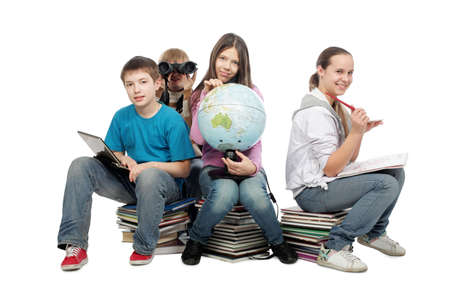 Educational theme: group of emotional teenagers sitting together. Stock Photo