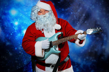 Christmas theme: Santa claus playing a guitar, snowy design.