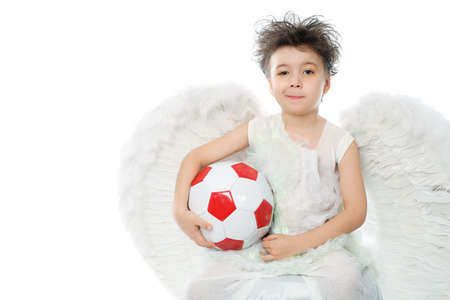 Beautiful little angel holding a ball. Isolated over white background. Stock Photo - 6098684