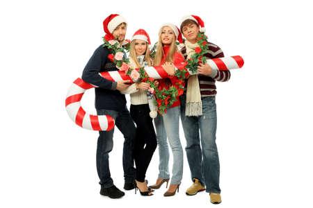 personas festejando: Grupo de j�venes, celebrando la Navidad. Foto de archivo