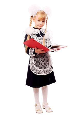 Portrait of a schoolgirl in uniform reading her book.  photo