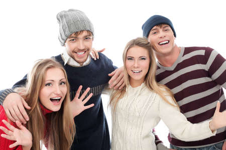 seasonal clothes: Group of cheerful young people in warm clothes. Stock Photo