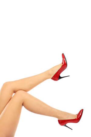 Female legs in elegant red shoes on white background Stock Photo - 6129998