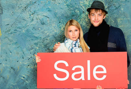 Two young people with advertisement board. Sale, shopping. photo