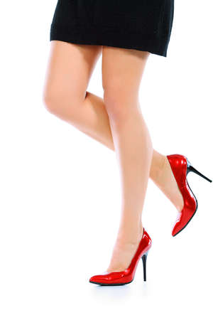 Female legs in elegant red shoes on white background Stock Photo - 6130051
